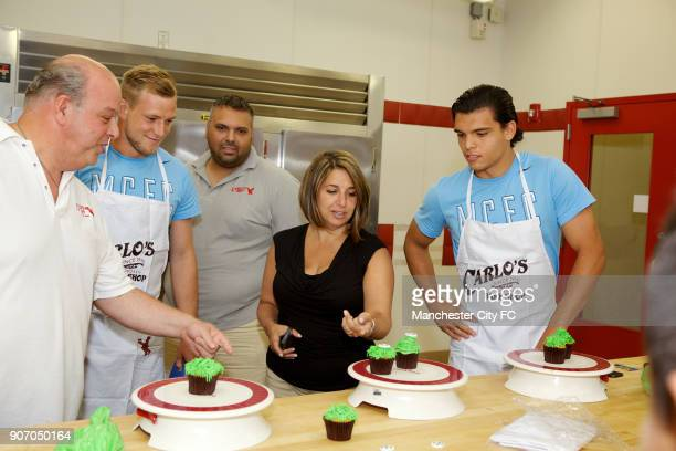 Manchester City FC Players visit Carlo's Bakery New Jersey Manchester City's John Guidetti and Karim Rekik during a visit to Carlo's Bakery where...