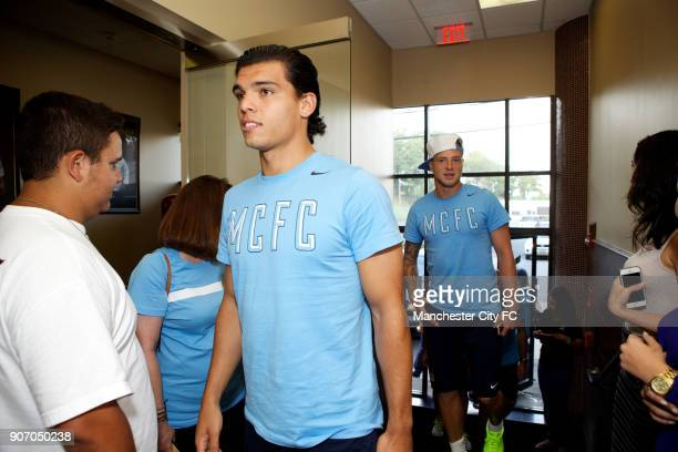 Manchester City FC Players visit Carlo's Bakery New Jersey Manchester City's Karim Rekik and John Guidetti during a visit to Carlo's Bakery where...