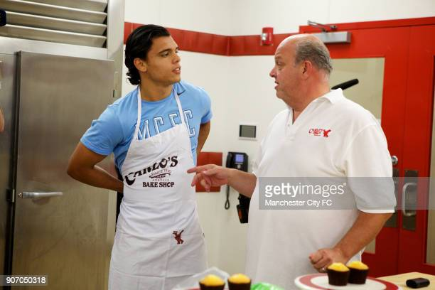 Manchester City FC Players visit Carlo's Bakery New Jersey Manchester City's Karim Rekik during a visit to Carlo's Bakery where they film the TV show...