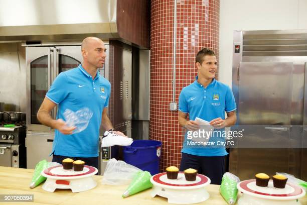 Manchester City FC Players visit Carlo's Bakery New Jersey Manchester City's Willy Caballero and Bruno Zuculini during a visit to Carlo's Bakery...