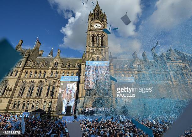 Manchester City football club players gather outside Manchester's Town Hall as they prepare to take part in a victory parade on an opentopped bus...