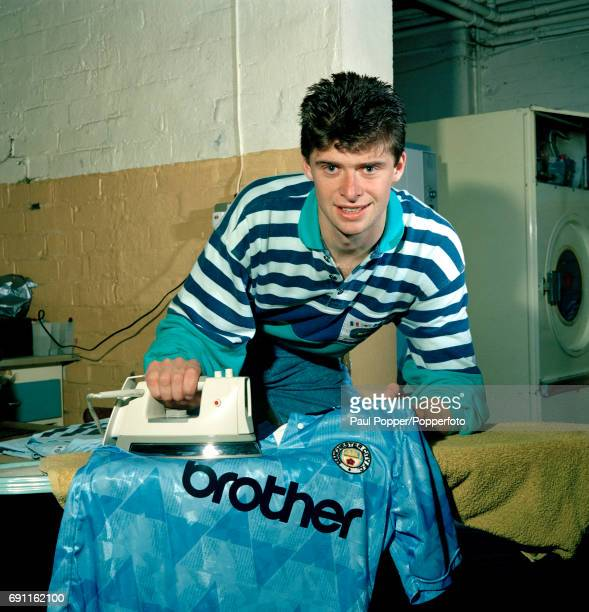 Manchester City footballer Niall Quinn ironing his new shirt at Maine Road in Manchester circa August 1992