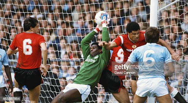 Manchester City goalkeeper Alex Williams collects the ball under pressure from Paul McGrath during a League Division One match between Manchester...