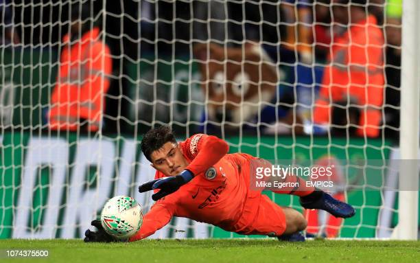 Manchester City goalkeeper Arijanet Muric saves a penalty from Leicester City's James Maddison in the shootout Leicester City v Manchester City...