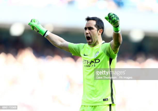 Manchester City goalkeeper Claudio Bravo celebrates Fabian Delph scoring his side's third goal of the game during the Premier League match at the...