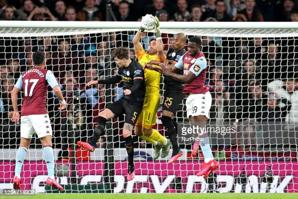 Manchester City goalkeeper Claudio Bravo makes a save from Aston Villa forward Keinan Davis during the Carabao Cup Final between Aston Villa and...