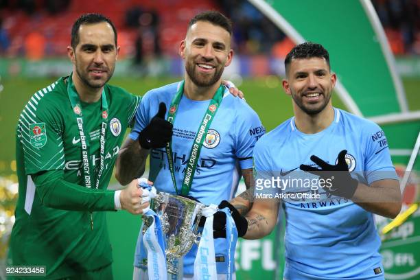Manchester City goalkeeper Claudio Bravo Nicolas Otamendi and Sergio Aguero of Manchester City pose with the trophy during the Carabao Cup Final...