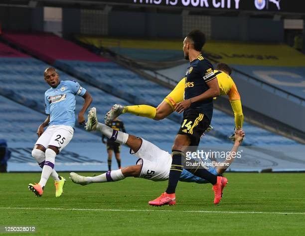 Manchester City goalkeeper Ederson collides with team mate Eric Garcia during the Premier League match between Manchester City and Arsenal FC at...