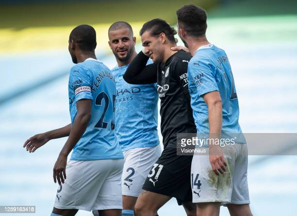 Manchester City goalkeeper Ederson is congratulated by his team mates after winning the Golden Glove for the most clean sheets in a season during the...