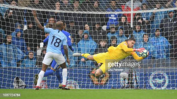 Manchester City goalkeeper Ederson makes a diving save during the Premier League match between Cardiff City and Manchester City at Cardiff City...