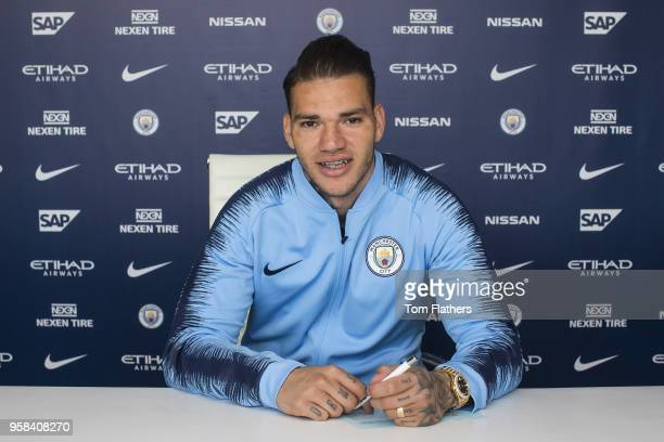 Manchester City goalkeeper Ederson signs a new contract at Manchester City Football Academy on May 10 2018 in Manchester England