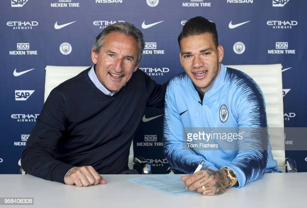 Manchester City goalkeeper Ederson with Director of Football Txiki Begiristain after signing a new contract at Manchester City Football Academy on...