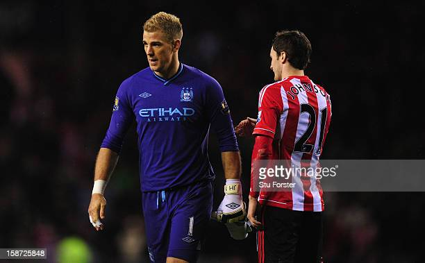 Manchester City goalkeeper Joe Hart is consoled by Adam Johnson after the Barclays Premier League match between Sunderland and Manchester City at...