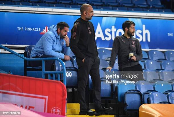 Manchester City goalkeeper Scott Carson and manager Pep Guardiola and during the Premier League match at Elland Road, Leeds.