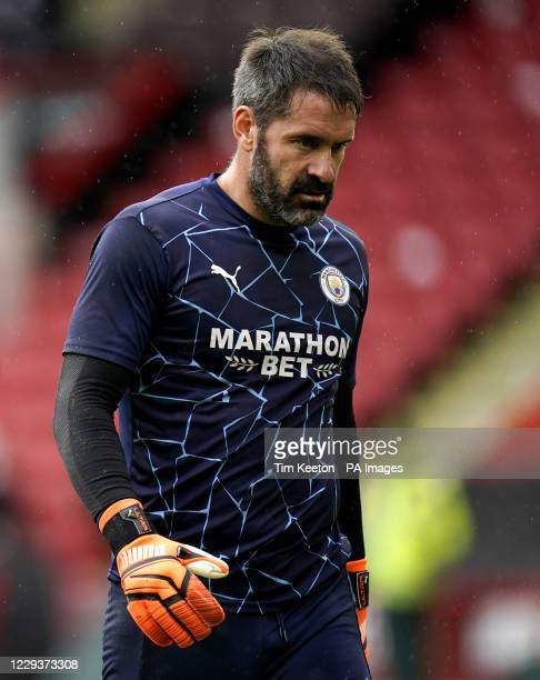 Manchester City goalkeeper Scott Carson walks off the pitch after suffering an injury in the warm up before the Premier League match at Bramall Lane,...