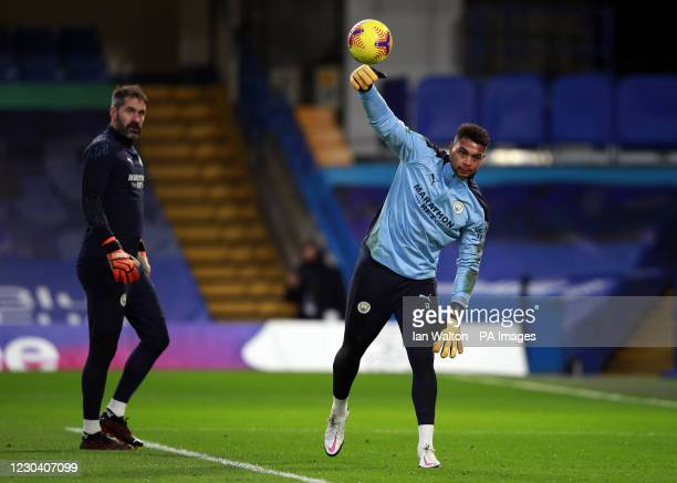 Manchester City goalkeeper Zack Steffen warms up watched by Scott Carson before the Premier League match at Stamford Bridge, London.
