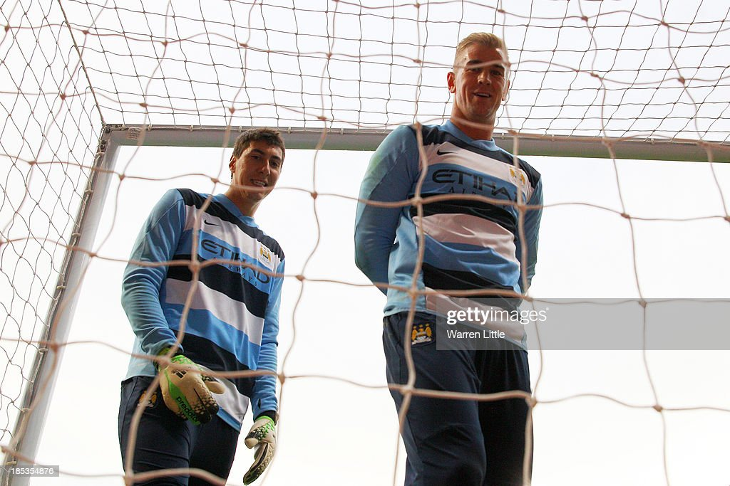 Manchester City goalkeepers Costel Pantilimon and Joe Hart look on prior to kickoff during the Barclays Premier League match between West Ham United and Manchester City at Boleyn Ground on October 19, 2013 in London, England.