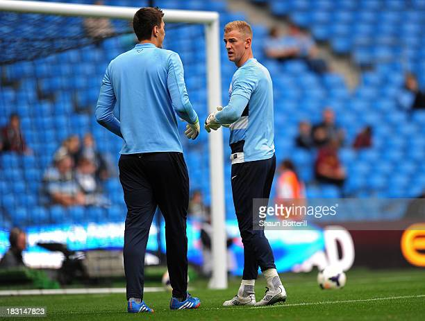 Manchester City goalkeepers Costel Pantilimon and Joe Hart speak during the pre match warm up prior to kickoff during the Barclays Premier League...