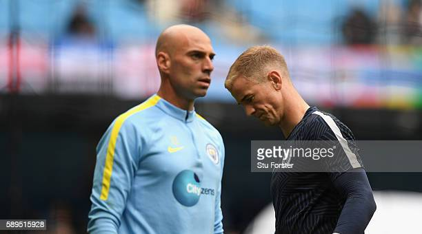 Manchester City goalkeepers Willy Caballero and Joe Hart look on during the warm up before the Premier League match between Manchester City and...