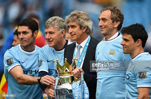 Manchester City Goalkeeping Coach Xabier Mancisidor Joint Assistant Manager Brian Kidd Manager Manuel Pellegrini and Joint Assistant Manager Ruben...