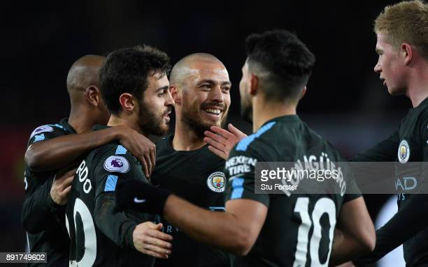 Manchester City goalscorer David Silva celebrates his opening goal with team mates during the Premier League match between Swansea City and...