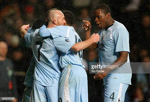 Manchester City goalscorer Stephen Ireland celebrates with Nedum Onuoha after scoring during the UEFA Cup round of 32 1st leg game between FC...
