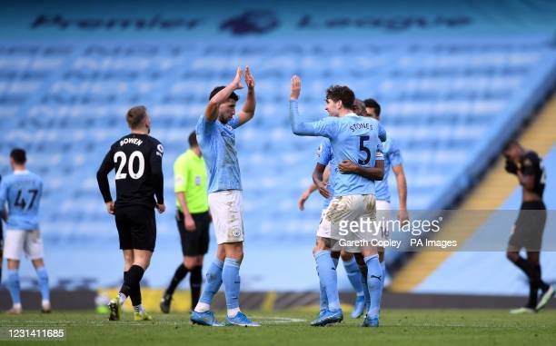 Manchester City goalscorers Ruben Dias and John Stones following the Premier League match at the Etihad Stadium, Manchester. Picture date: Saturday...