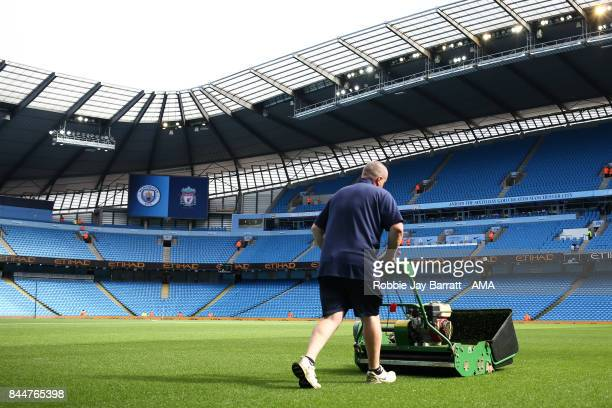 Manchester City groundsman works on the pitch prior to the Premier League match between Manchester City and Liverpool at Etihad Stadium on September...