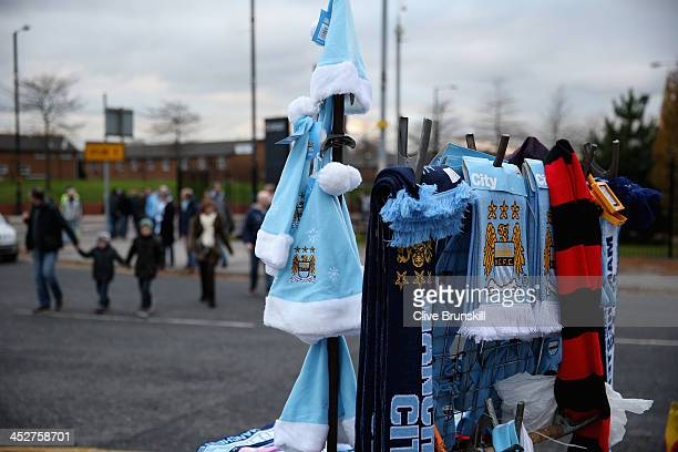 Manchester City hats and scarfs outside the stadium prior to the Barclays Premier League match between Manchester City and Swansea City at the Etihad...
