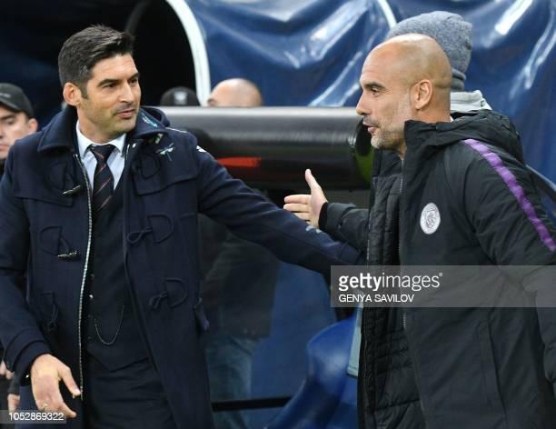 Manchester City head coach Josep Guardiola speaks to Shakhtar Donetsk's Portuguese coach Paulo Fonseca during the UEFA Champions League football...