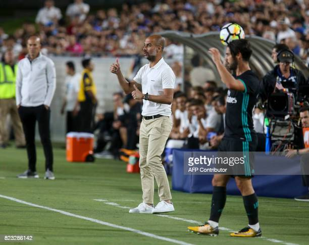 Manchester City head coach Pep Guardiola looks on in the first half of the International Champions Cup match against Real Madrid during their...