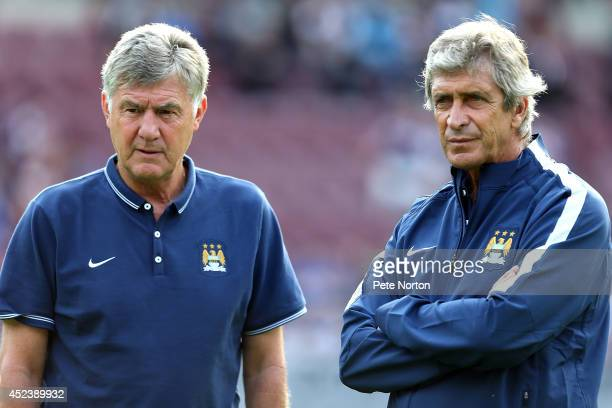 Manchester City imanager Manuel Pellegrini looks on with joint assistant Brian Kidd prior to the Pre Season Friendly match between Hearts and...
