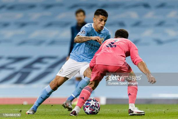 Manchester City João Cancelo fights for the ball with Daniel Carvajal of Real Madrid during the UEFA Champions League round of 16 second leg match...