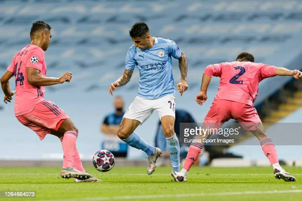 Manchester City João Cancelo fights for the ball with Daniel Carvajal and Carlos Casemiro of Real Madrid during the UEFA Champions League round of 16...
