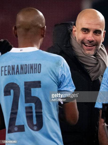 Manchester City Manager / Head Coach Pep Guardiola celebrates with Fernandinho of Manchester City at the end of the Carabao Cup Semi Final match...