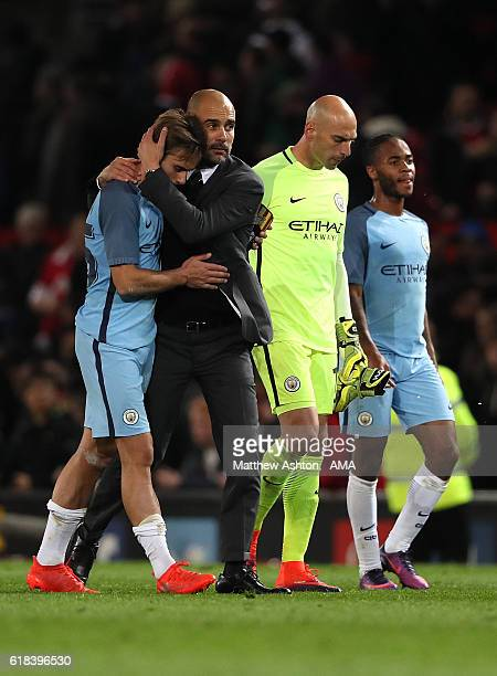 Manchester City Manager / Head Coach Pep Guardiola consoles Aleix Garcia at the end of the EFL Cup Fourth Round match between Manchester United and...