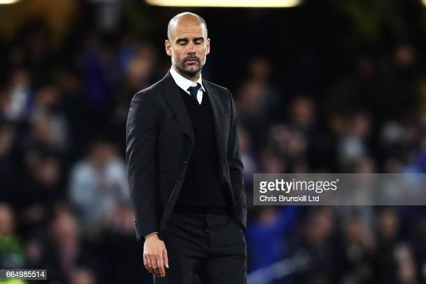Manchester City Manager / Head Coach Pep Guardiola looks dejected at the end of the Premier League match between Chelsea and Manchester City at...