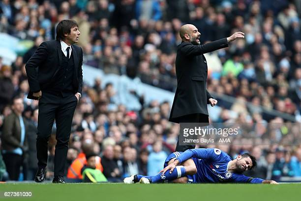 Manchester City Manager / Head Coach Pep Guardiola reacts as Antonio Conte looks on during the Premier League match between Manchester City and...