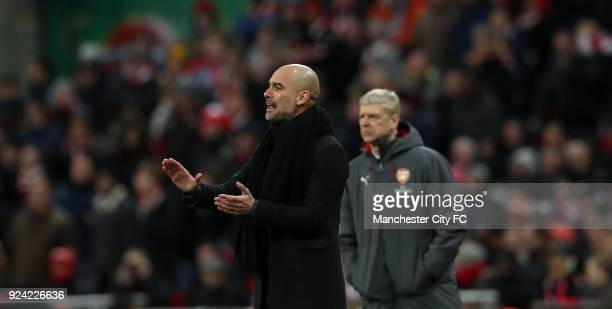 Manchester City Manager Josep Guardiola and Arsene Wenger manager of Arsenal during the Carabao Cup Final between Arsenal and Manchester City at...