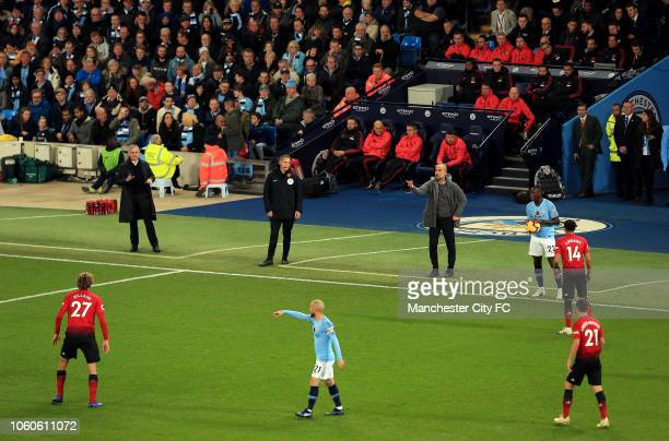 Manchester City Manager Josep Guardiola and Manchester United Manager Jose Mourinho look on during the Premier League match between Manchester City...