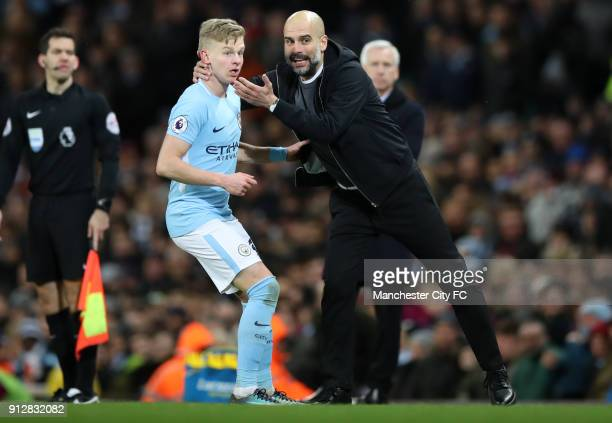 Manchester City Manager Josep Guardiola and Oleksandr Zinchenko of Manchester City during the Premier League match between Manchester City and West...