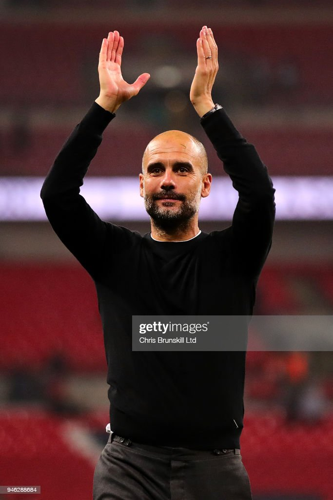 Manchester City manager Josep Guardiola applauds the supporters following the Premier League match between Tottenham Hotspur and Manchester City at Wembley Stadium on April 14, 2018 in London, England.