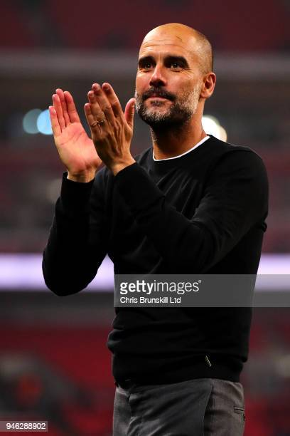 Manchester City manager Josep Guardiola applauds the supporters following the Premier League match between Tottenham Hotspur and Manchester City at...