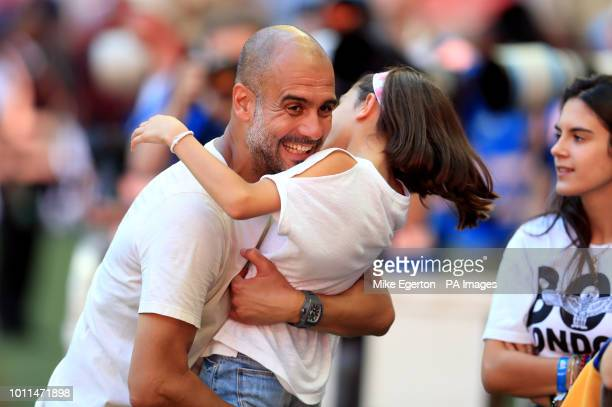 Manchester City manager Josep Guardiola celebrates with his daughter Valentina Guardiola after the Community Shield match at Wembley Stadium London
