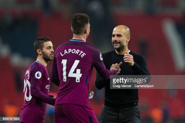 Manchester City manager Josep Guardiola celebrates with Manchester City's Aymeric Laporte after the Premier League match between Tottenham Hotspur...