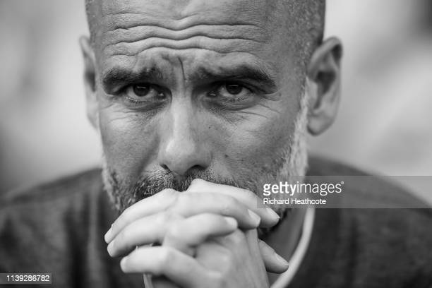Manchester City manager Josep Guardiola looks on before the Premier League match between Fulham FC and Manchester City at Craven Cottage on March 30...