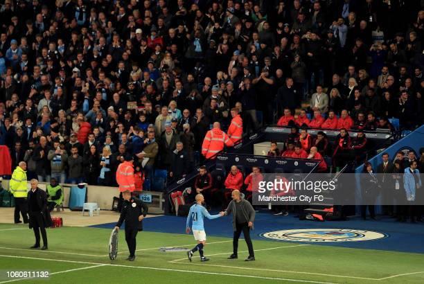 Manchester City Manager Josep Guardiola substitutes David Silva during the Premier League match between Manchester City and Manchester United at...