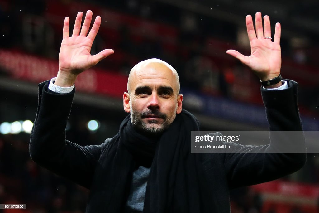 Manchester City manager Josep Guardiola waves to the crowd following the Premier League match between Stoke City and Manchester City at Bet365 Stadium on March 12, 2018 in Stoke on Trent, England.