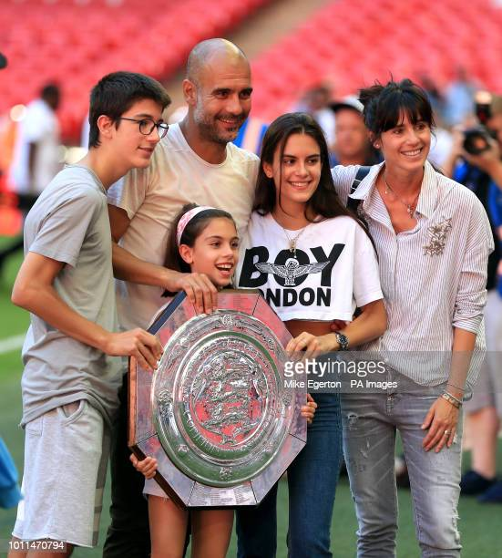 Manchester City manager Josep Guardiola with the Community Shield trophy and family wife Cristina Serra and children Valentina Guardiola, Maria...