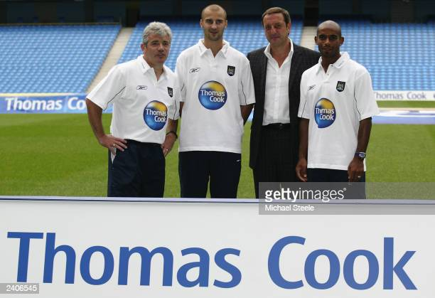 Manchester City manager Kevin Keegan new Manchester City signing Antoine Sibierski chief executive of Thomas Cook UK and Ireland Manny FontenlaNovoa...